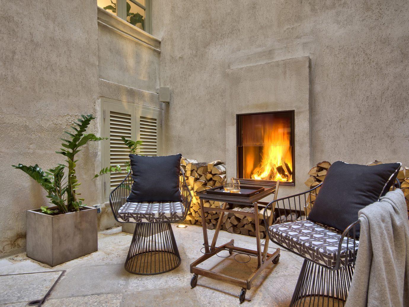 Hotels Living room property hearth house living room home Fireplace estate floor wood cottage interior design stone Villa backyard farmhouse furniture area