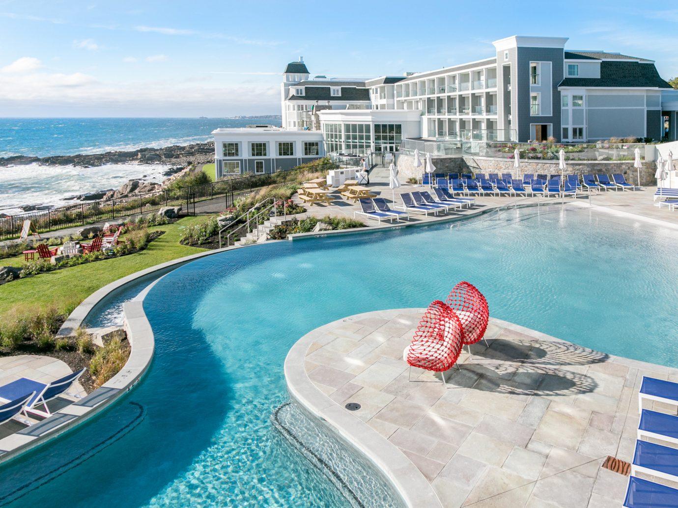 Hotels sky outdoor water leisure swimming pool vacation Sea Resort Pool Ocean estate marina Coast Beach Water park dock caribbean bay walkway shore