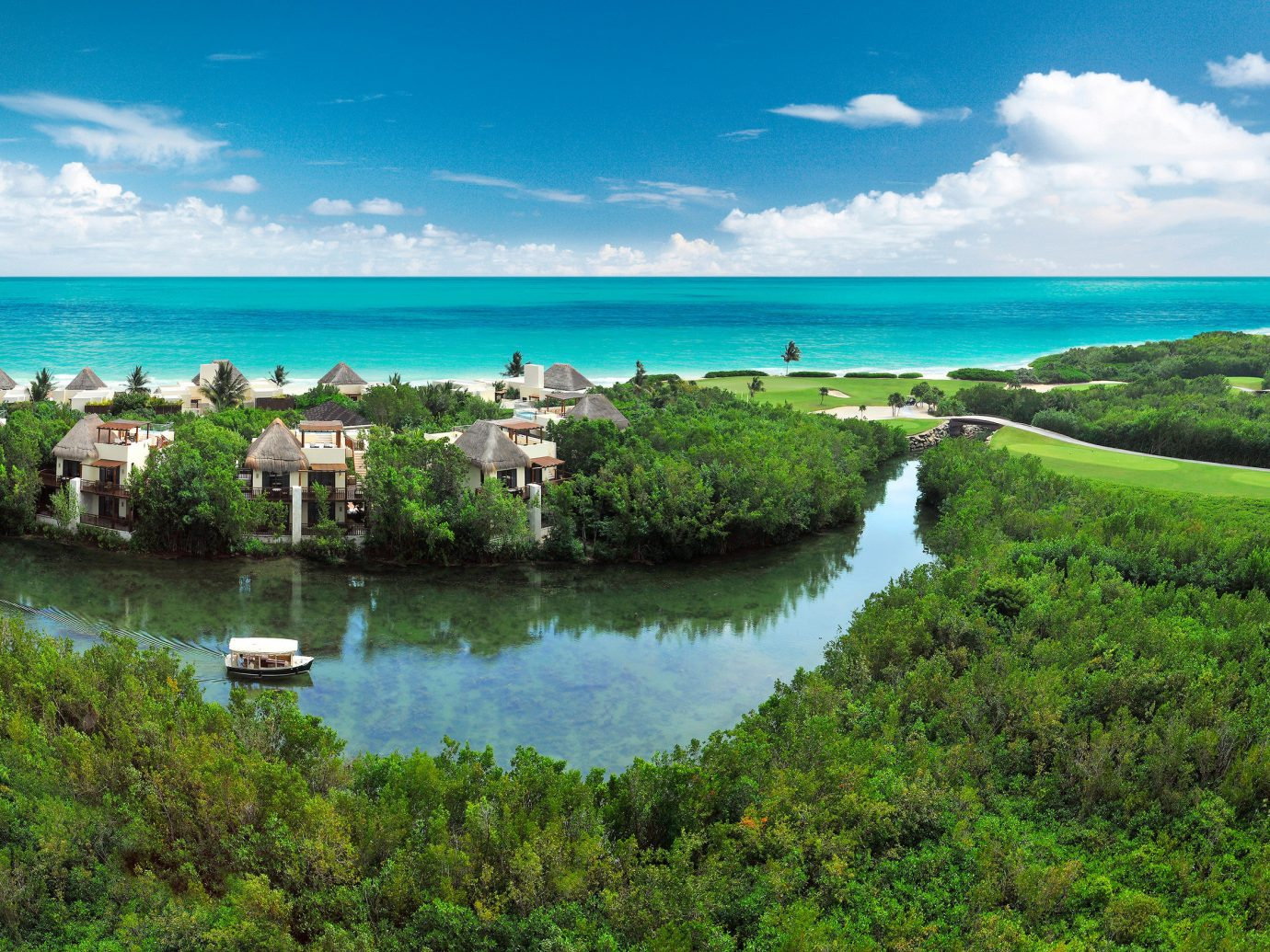 Hotels Travel Tips Trip Ideas grass sky outdoor water habitat Nature shore Coast Sea vacation bay Lagoon islet cape terrain lush
