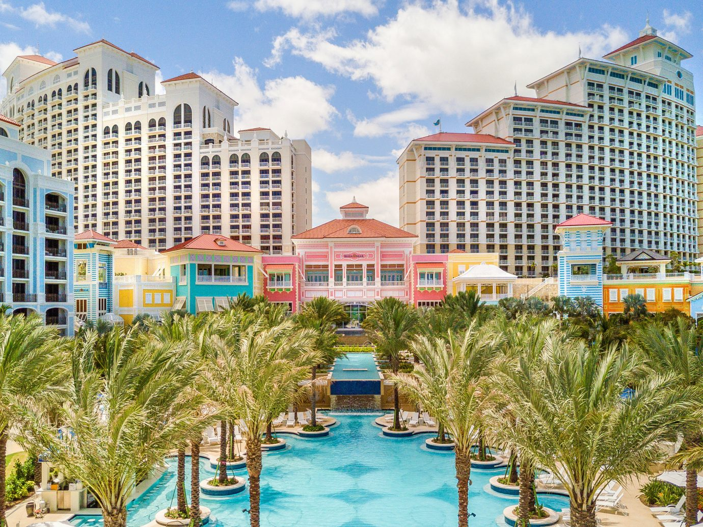 Boutique Hotels Hotels Luxury Travel outdoor Resort condominium mixed use hotel metropolitan area palm tree real estate leisure arecales vacation City swimming pool tourism water building tree recreation apartment lined several sandy