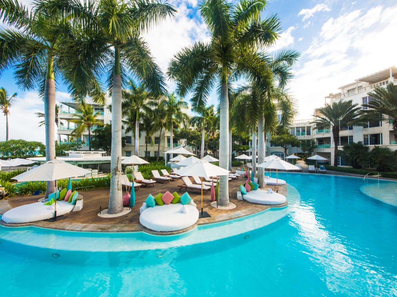 Trip Ideas tree outdoor water table sky Resort Pool swimming pool leisure property vacation Water park swimming caribbean arecales condominium estate resort town marina Villa blue palm lined