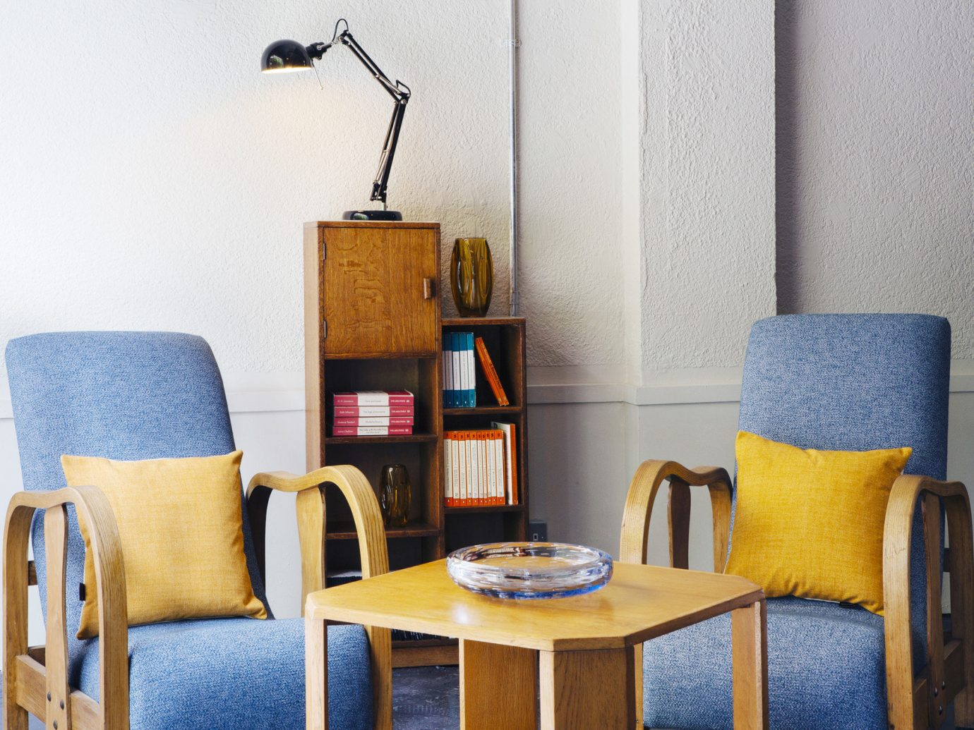 charming cozy Hotels living area Lounge lounge chairs Rustic Solo Travel wall color indoor blue room chair yellow living room dining room furniture home interior design Design window covering apartment cottage