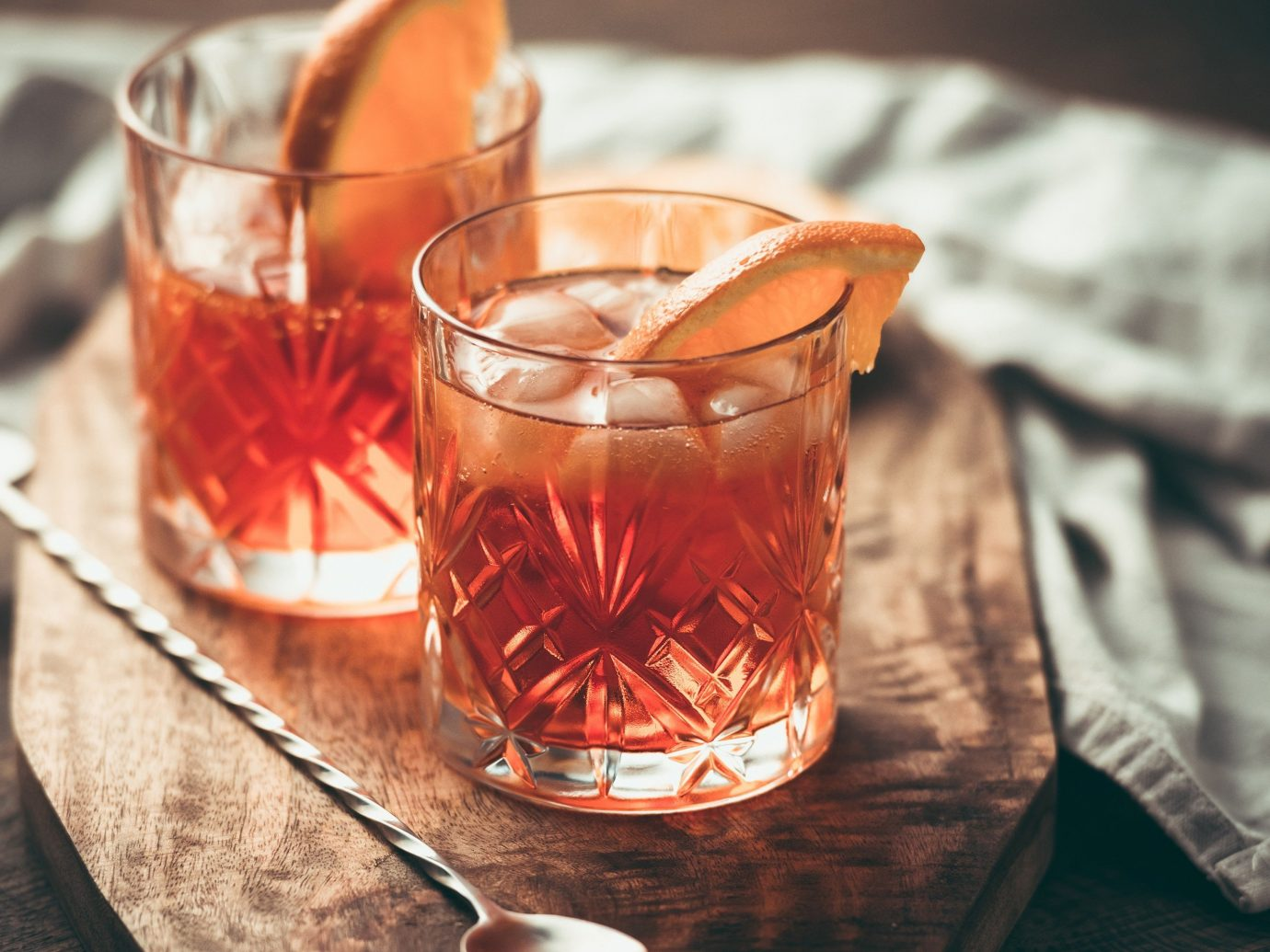 Offbeat table cup food sitting indoor glass Drink alcoholic beverage distilled beverage container whisky slice old fashioned negroni beverage alcohol close meal sliced
