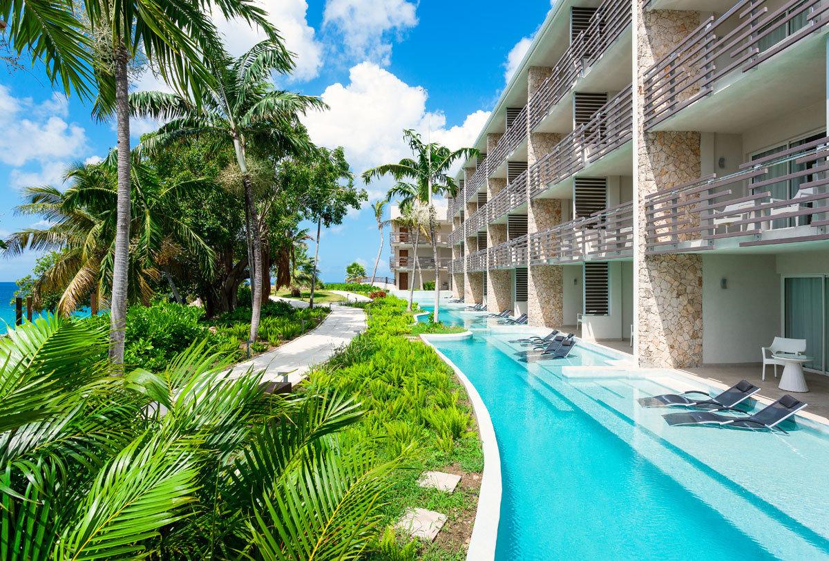 Trip Ideas tree outdoor leisure Resort swimming pool condominium vacation arecales estate tourism Pool caribbean palm family tropics plant area