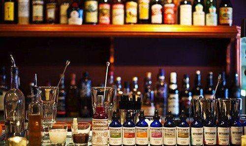 Food + Drink bottle wine indoor shelf glasses alcoholic beverage Drink distilled beverage Bar alcohol full beverage several
