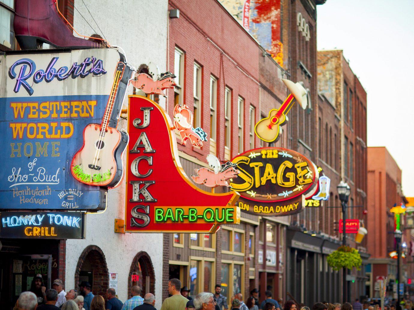 Arts + Culture Austin Nashville Offbeat Trip Ideas building outdoor street road City people Downtown festival fair amusement park sign