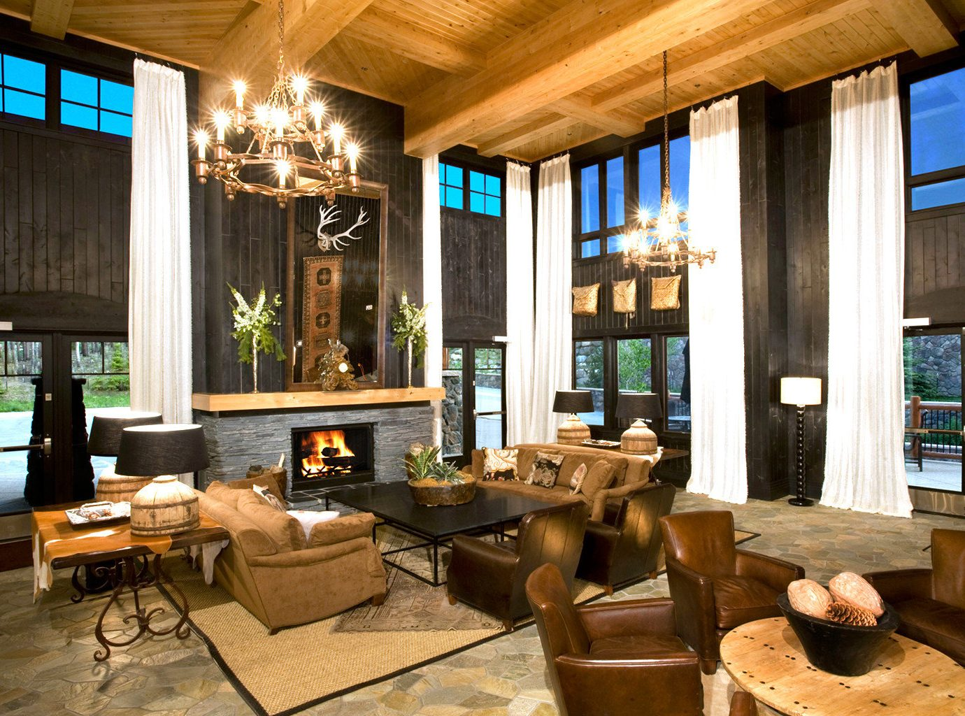 Fireplace Lobby Lodge Lounge Outdoor Activities Romantic Ski Trip Ideas window table indoor property room estate ceiling living room home interior design wood real estate Resort restaurant mansion Design condominium Villa furniture
