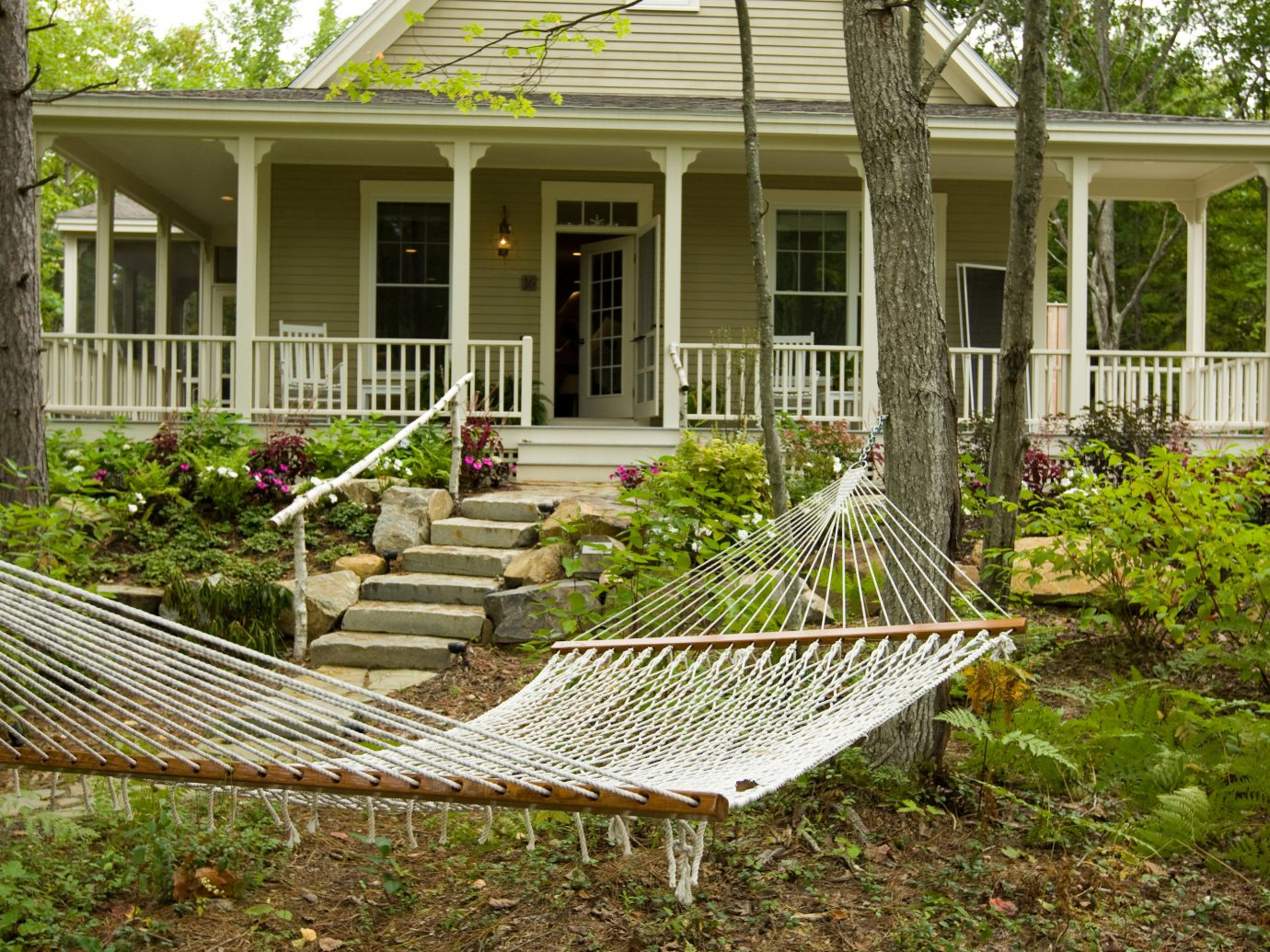 Romance Trip Ideas Weekend Getaways outdoor grass building house property bed home cottage furniture lawn backyard porch yard real estate residential area plant outdoor structure tree outdoor furniture Garden walkway plantation farmhouse siding estate landscaping facade