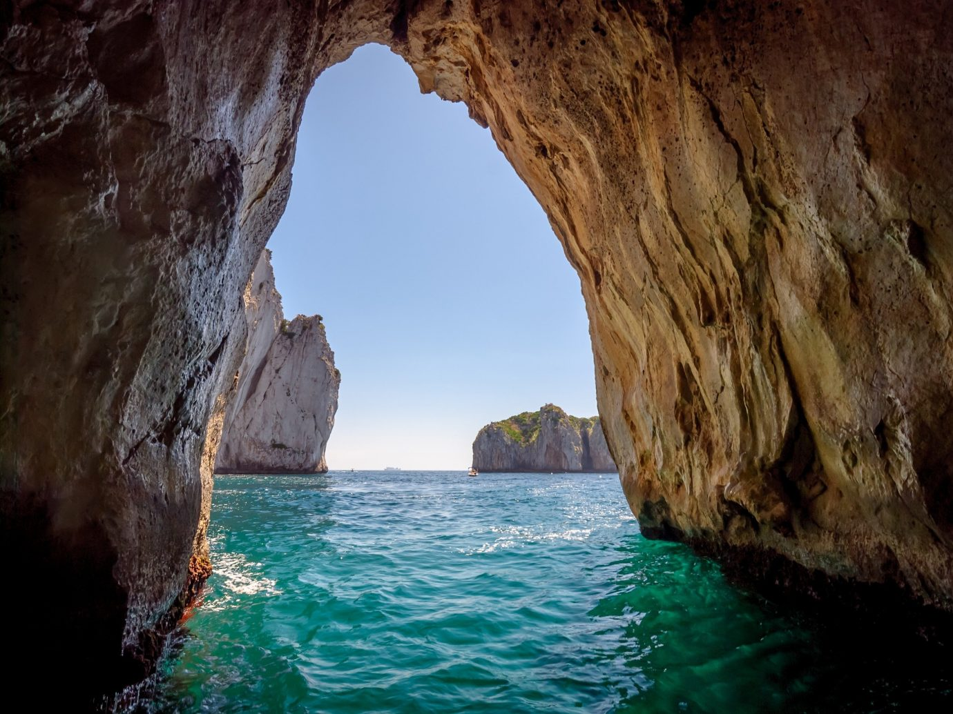 Trip Ideas water outdoor rock Nature sea cave geographical feature landform cave mountain natural arch cliff Sea terrain formation Coast wadi distance day
