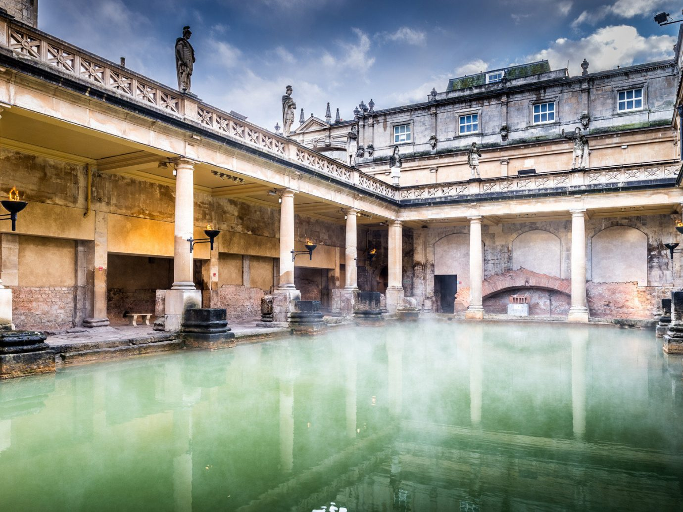 Health + Wellness Luxury Travel Road Trips Trip Ideas building water outdoor reflection landmark thermae tourist attraction estate ancient rome historic site sky tourism symmetry water feature ancient history hacienda facade stone rainy