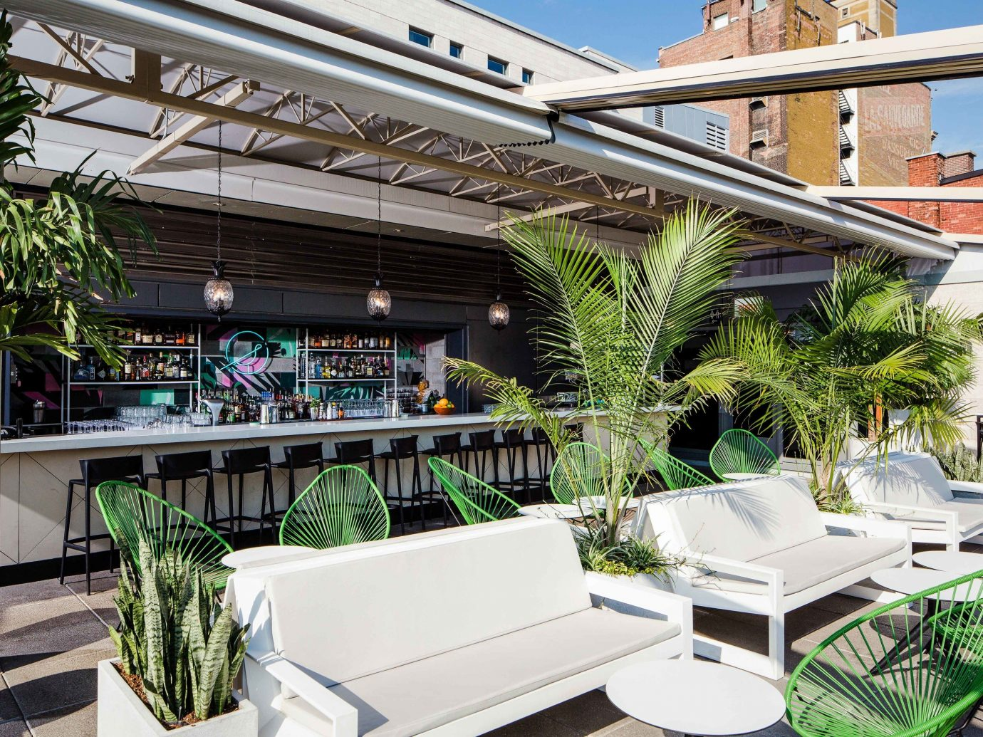 Canada Hotels Montreal Trip Ideas property real estate roof plant arecales palm tree Resort apartment Balcony outdoor structure Patio tree condominium