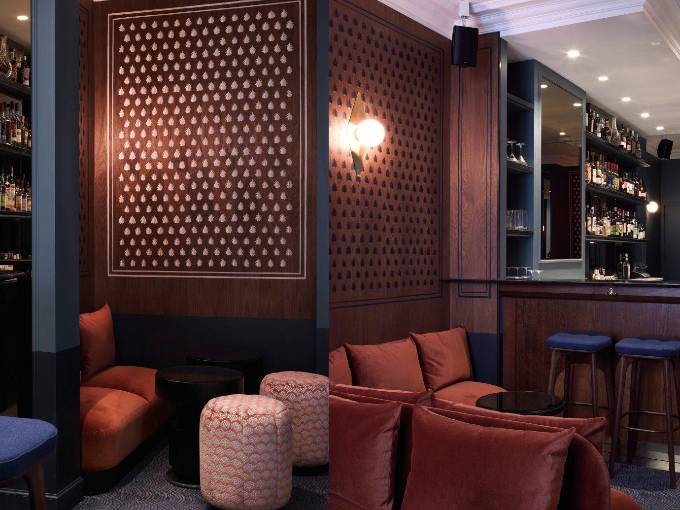 Jetsetter Guides indoor chair room Lobby interior design Bar living room restaurant Design window covering furniture