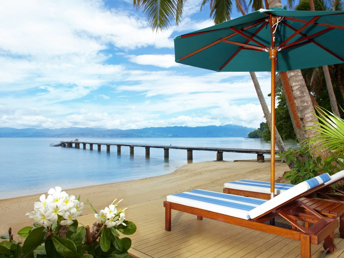 All-Inclusive Resorts Hotels Luxury Travel umbrella sky outdoor chair Resort Sea vacation accessory leisure real estate tourism tropics Beach outdoor furniture Ocean caribbean shore set furniture Deck