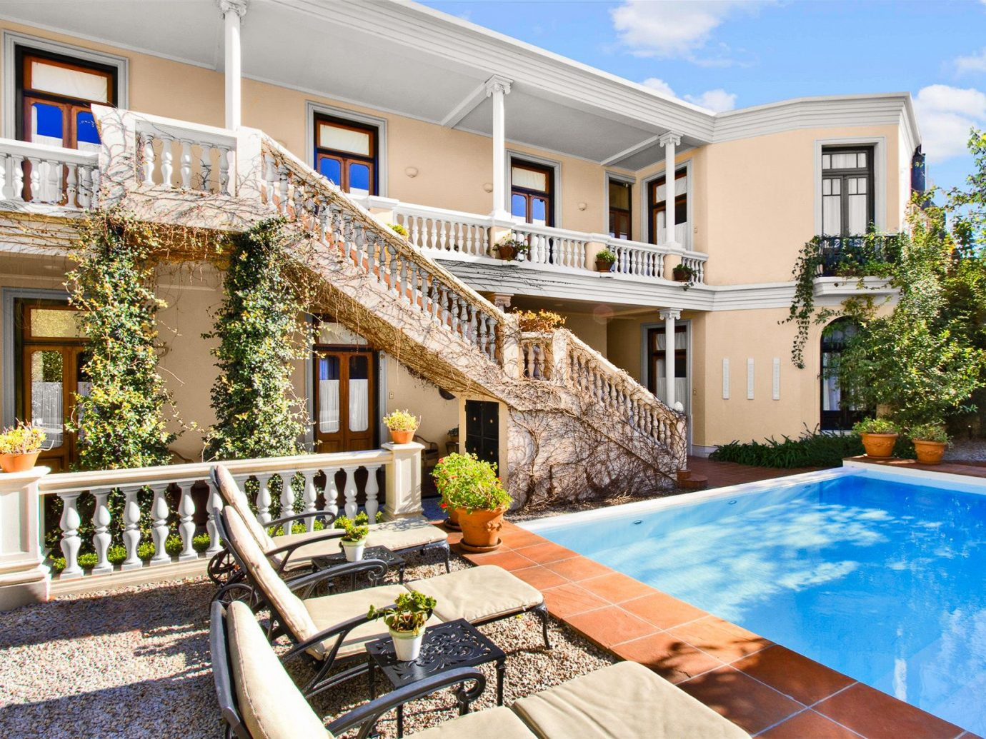 Boutique Hotels Luxury Travel building outdoor ground property home real estate house estate Villa apartment swimming pool backyard leisure facade elevation Resort cottage outdoor structure window condominium