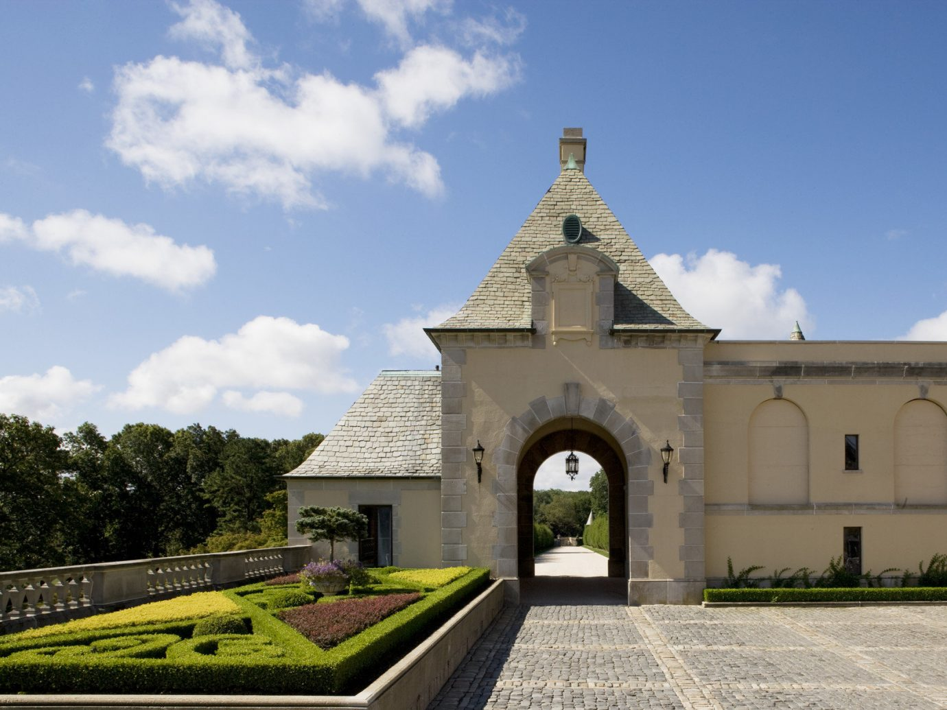 Architecture building Courtyard Design Exterior flowers Garden Greenery Luxury Nature park remote Style + Design trees Trip Ideas sky outdoor landmark estate place of worship Church monastery chapel spanish missions in california château stone