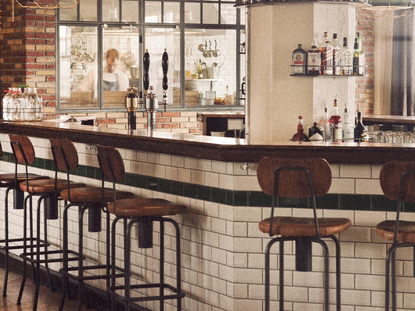 Boutique Hotels Hotels Iceland Reykjavík Trip Ideas indoor floor room furniture dining room table wood interior design restaurant Bar Design
