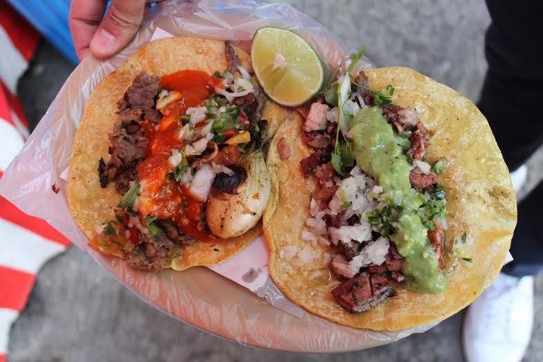 Food + Drink person food dish veggie burger falafel cuisine sloppy joe tostada meal produce meat taco snack food close