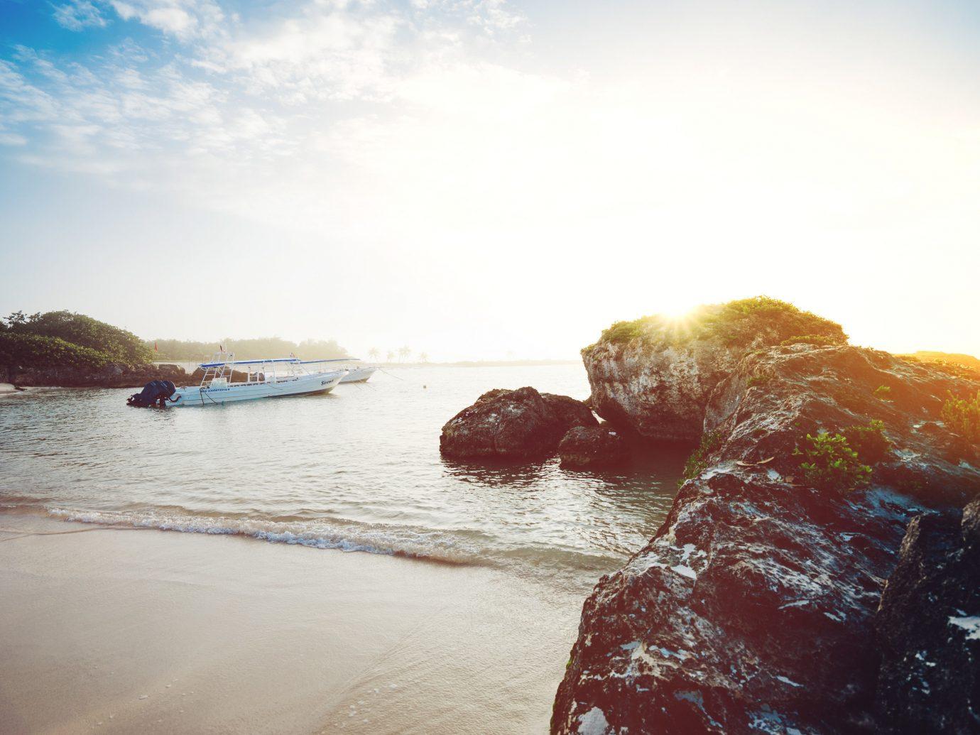 sky water outdoor Sea Ocean Beach wave shore reflection morning wind wave Coast sunlight Sunset vehicle sand