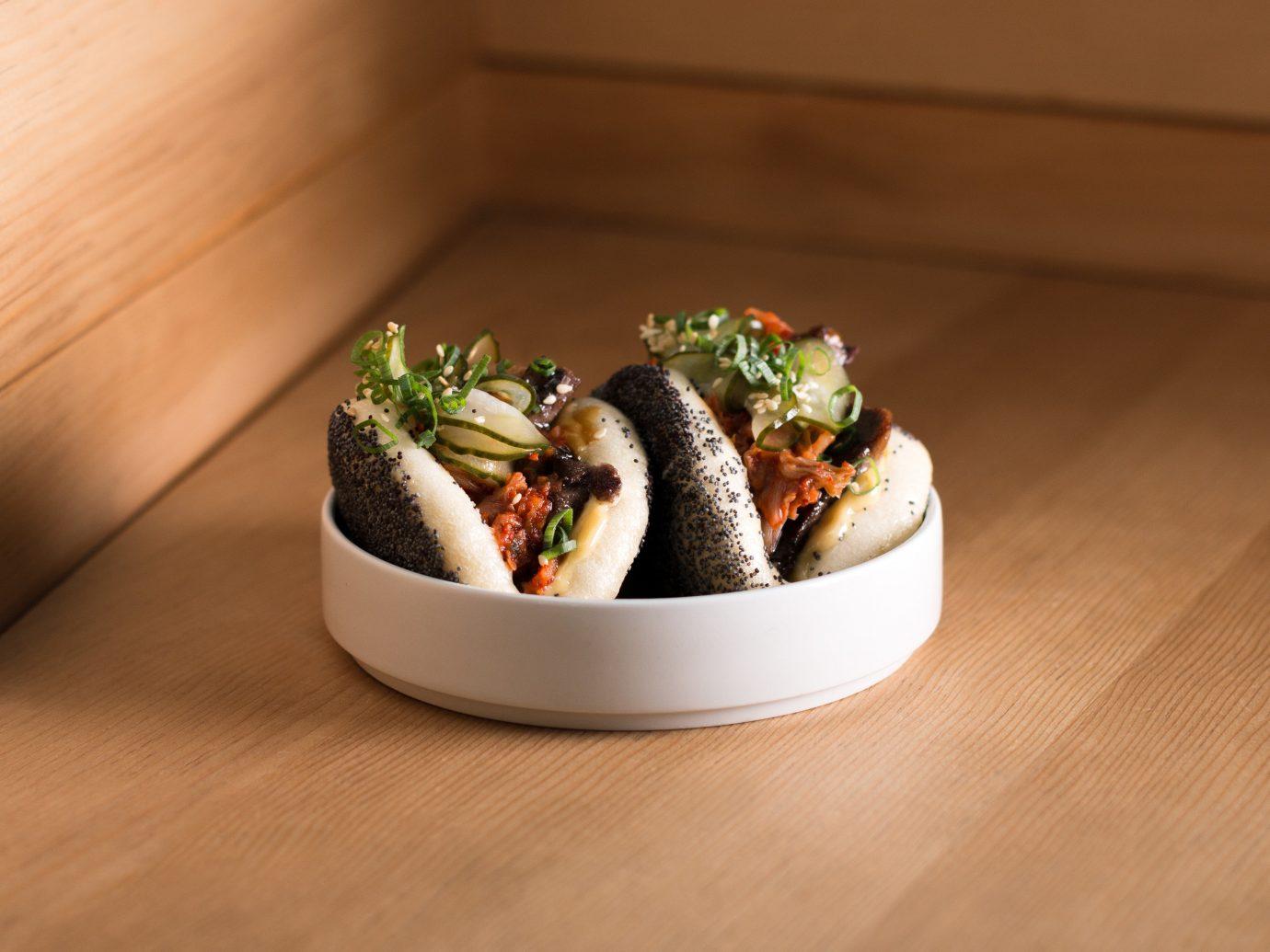 Food + Drink Travel Tips table indoor dish cuisine food appetizer japanese cuisine wooden asian food meal comfort food finger food recipe vegetable