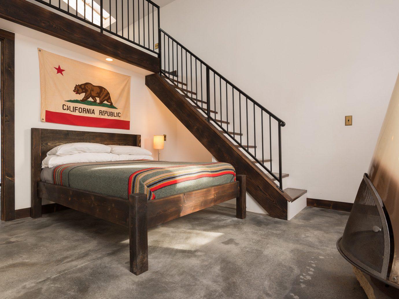 Boutique Hotels Fall Travel Hotels Outdoors + Adventure floor indoor wall room furniture bed frame Bedroom bed flooring interior design real estate wood Suite