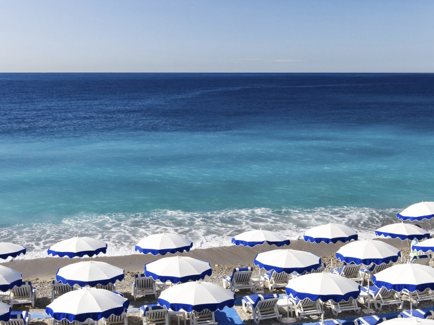 Offbeat Trip Ideas water umbrella sky outdoor Ocean Beach Sea blue body of water shore horizon wind wave wave vacation Coast cape enjoying swimming sandy day