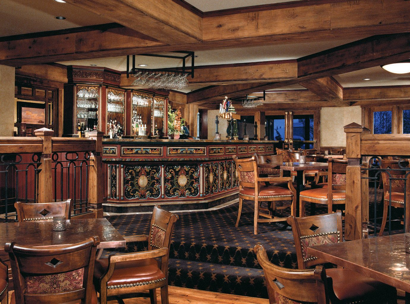 Dining Drink Eat Hotels Lodge Luxury Travel Mountains + Skiing Rustic indoor ceiling Kitchen chair room estate building Bar tavern restaurant home interior design mansion furniture Winery appliance area stainless wood Island steel table dining table dining room
