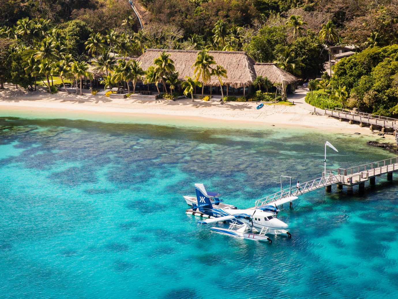 Boutique Hotels Hotels Luxury Travel water tree Sea outdoor coastal and oceanic landforms body of water Boat Coast Ocean bay Lagoon Pool tropics shore inlet caribbean swimming pool vacation water resources tourism Island leisure cove Beach Lake Resort resort town water feature landscape sky swimming cape pond surrounded