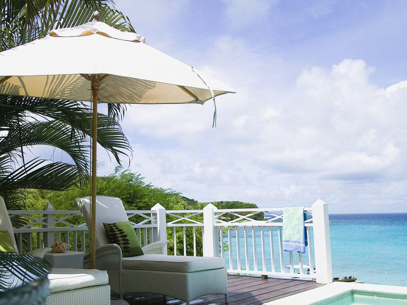 Trip Ideas sky tree chair outdoor Beach vacation caribbean Resort Villa umbrella estate swimming pool Sea cottage accessory furniture