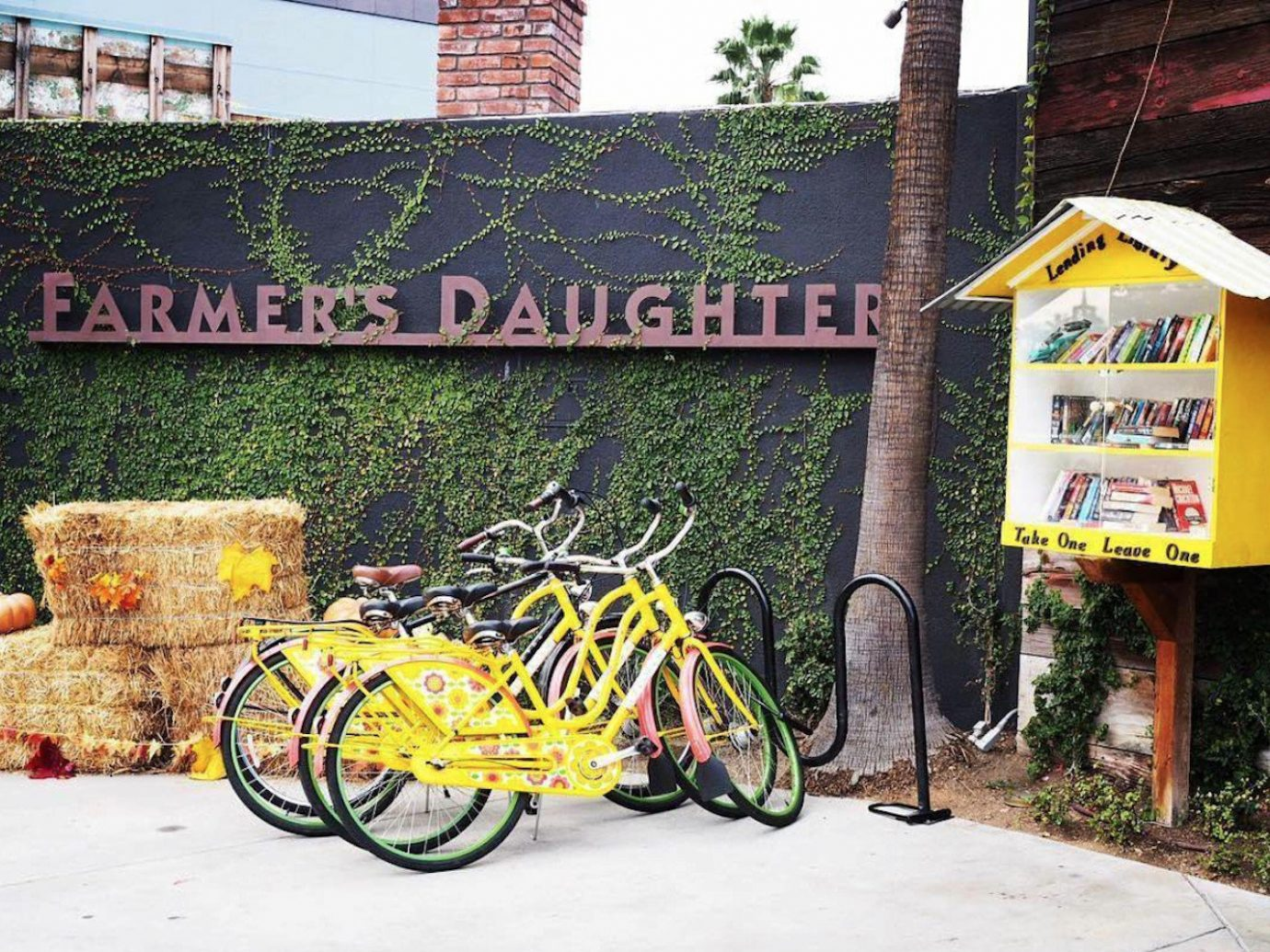 Hotels Style + Design Trip Ideas outdoor bicycle land vehicle ground yellow vehicle wall road bicycle neighbourhood recreation tree parked plant house mural cart pulling