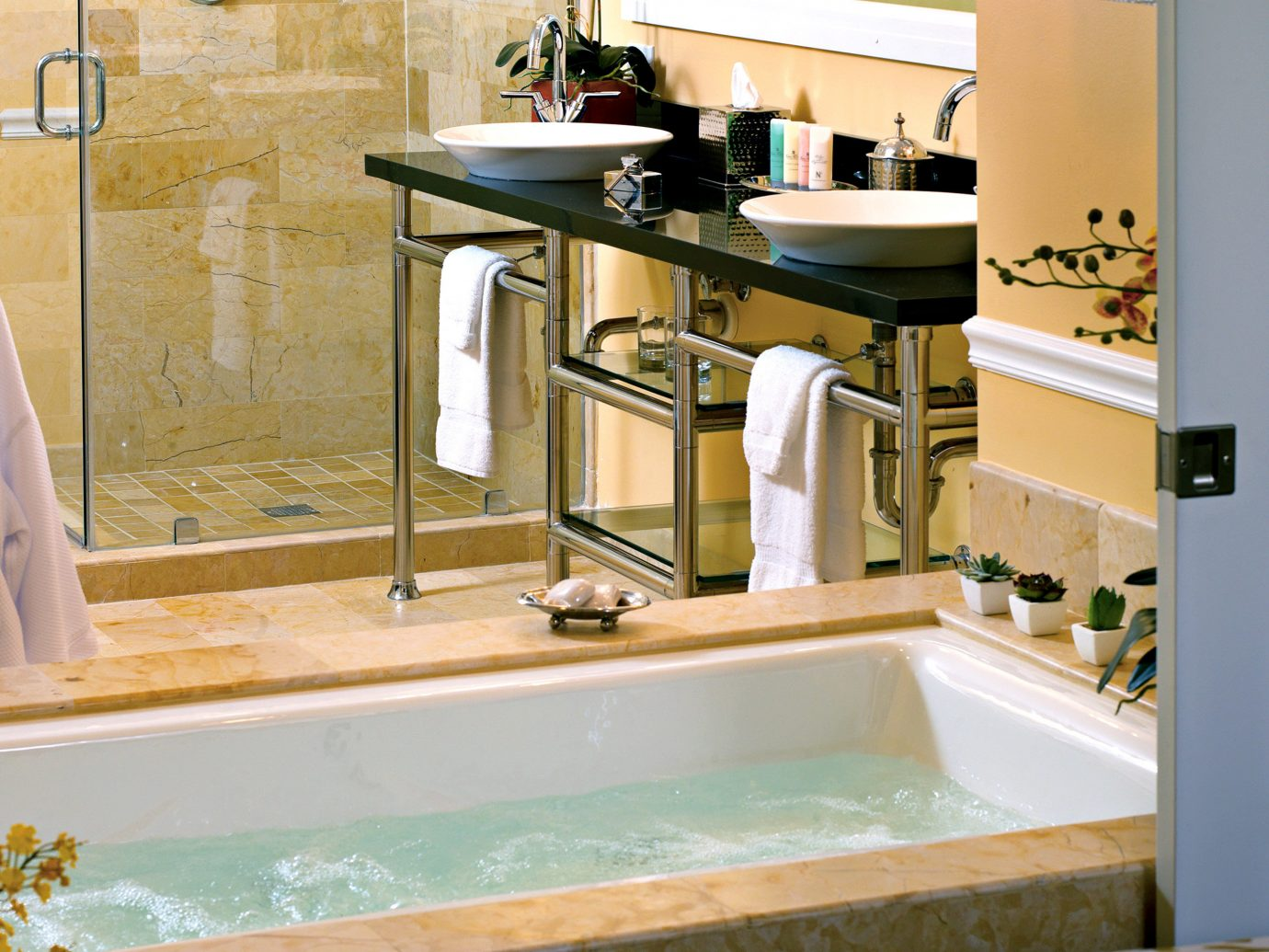 Bath Elegant Florida Hotels Resort indoor bathroom room sink property countertop swimming pool Kitchen plumbing fixture floor bathtub home toilet interior design estate flooring vessel counter tub water basin