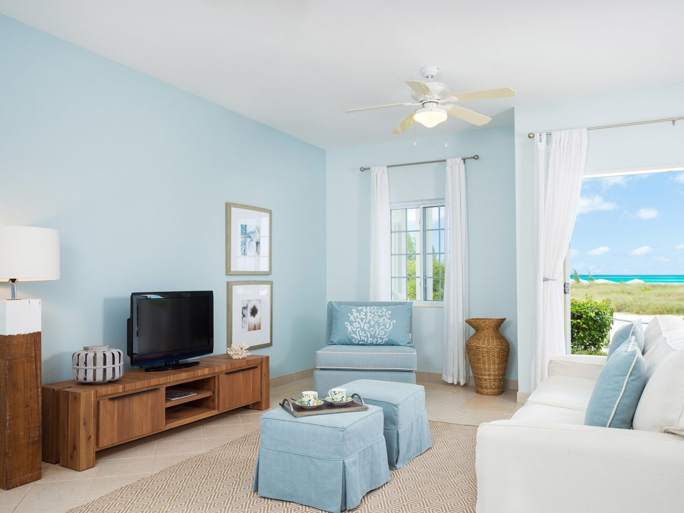 All-Inclusive Resorts Beachfront Boutique caribbean Living Luxury Resort indoor wall room floor sofa ceiling property Bedroom living room furniture home house real estate estate interior design cottage apartment flat Villa decorated