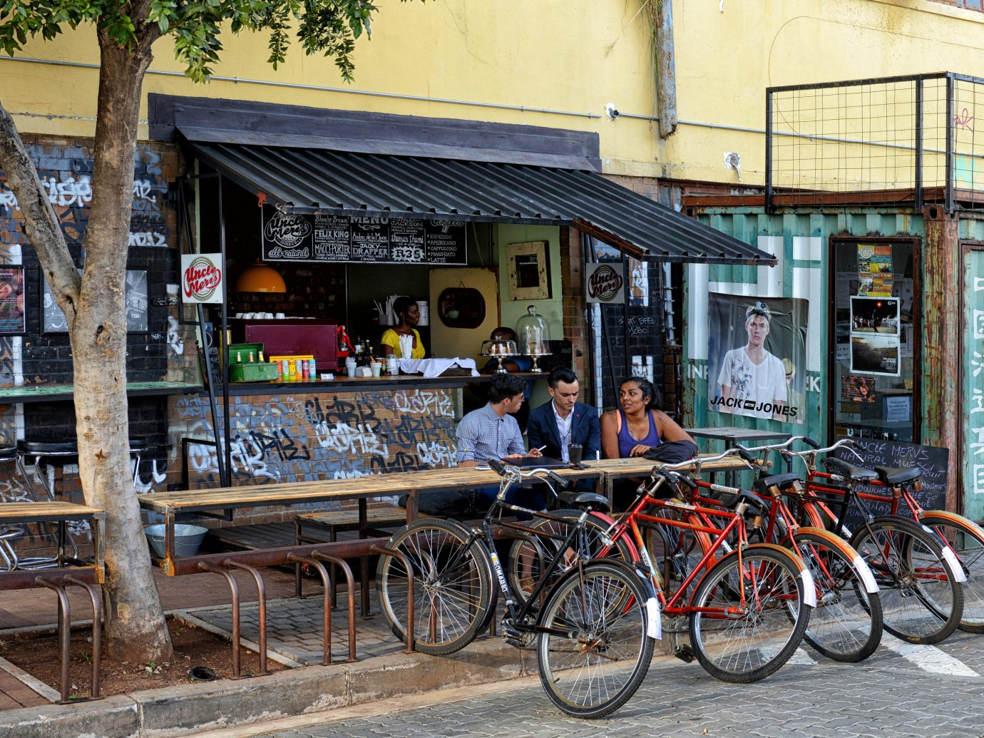 Trip Ideas outdoor building bicycle City road Town urban area neighbourhood human settlement street vehicle tourism parked transport market infrastructure horse-drawn vehicle pulling