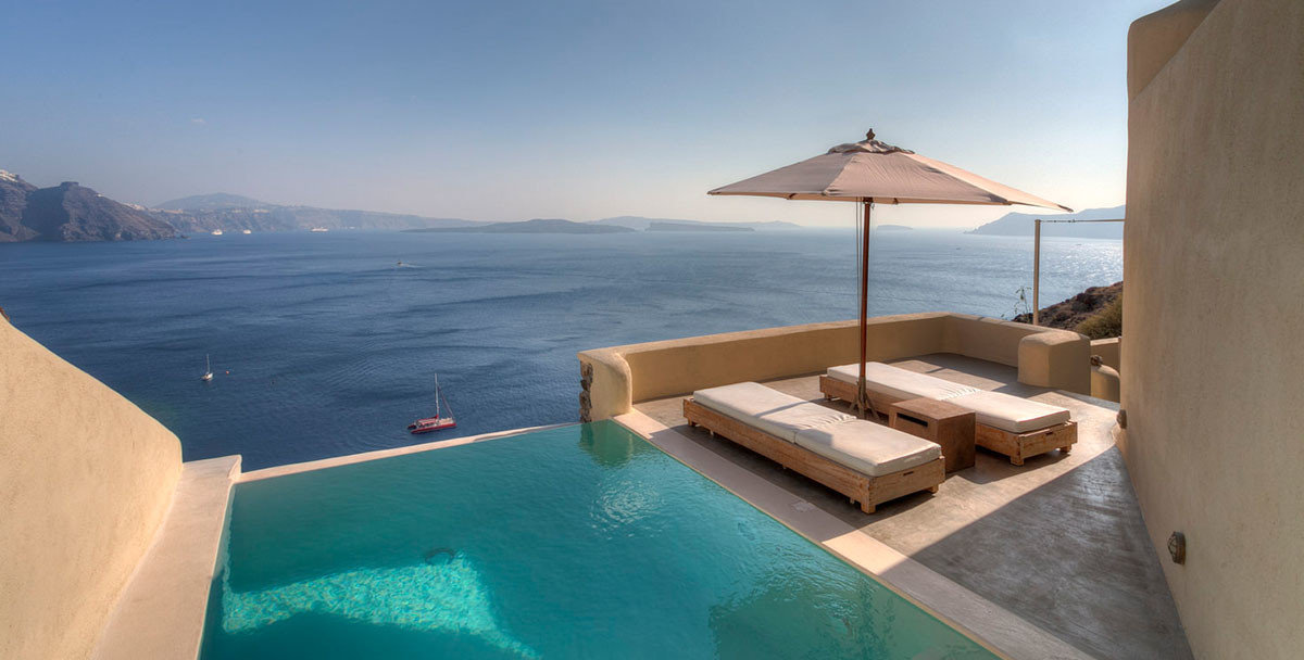 Hotels Luxury Travel sky water Sea property outdoor swimming pool vacation estate real estate Villa Ocean Resort amenity Island