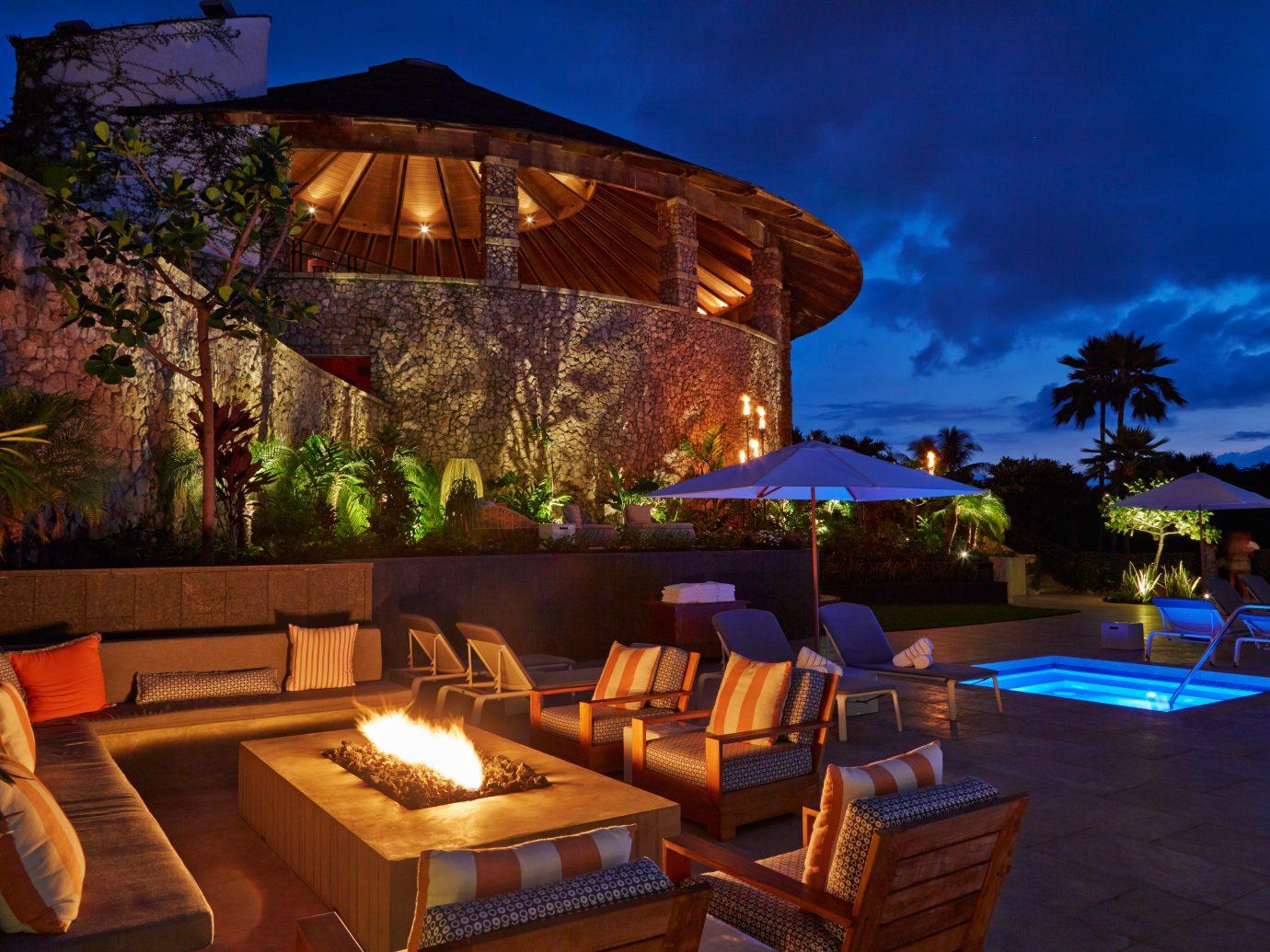 Beachfront Deck Eco Fireplace Hotels Island Lounge Patio Pool Romance Romantic Scenic views Sunset Waterfront outdoor Resort estate Villa landscape lighting swimming pool