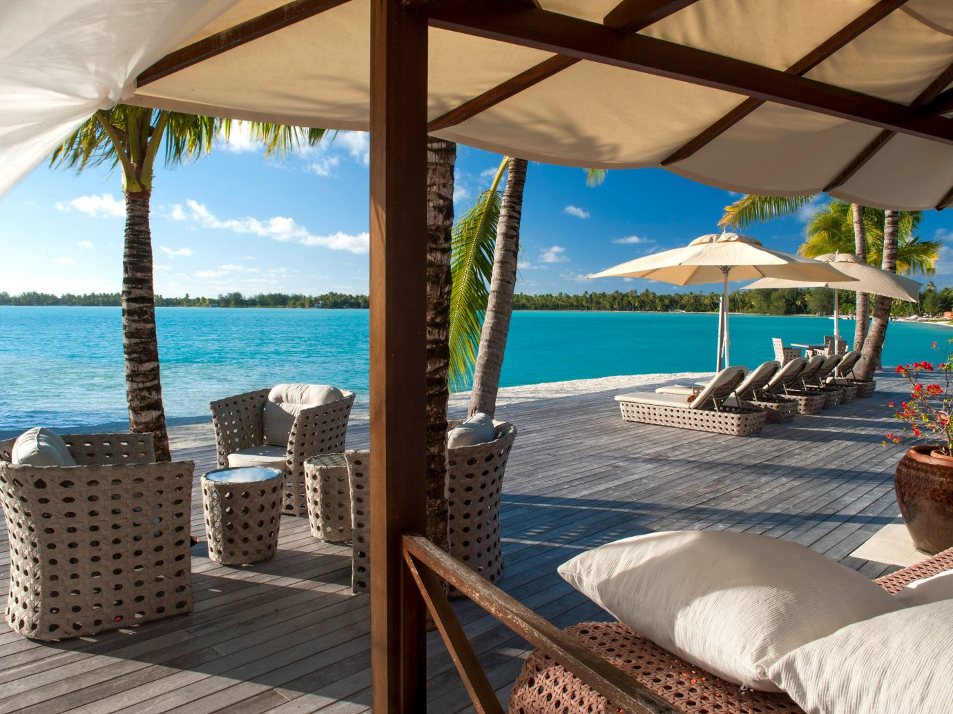 Beach Hotels Lounge Scenic views chair umbrella property leisure Resort vacation caribbean swimming pool estate Villa cottage overlooking furniture several