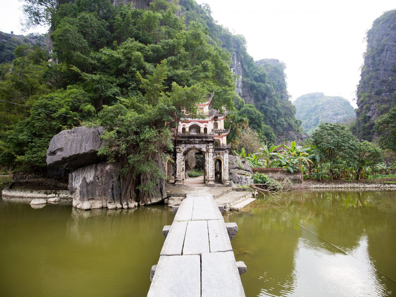tree outdoor water River Nature Lake mountain tourism waterway temple reservoir place of worship Village pond surrounded traveling stone