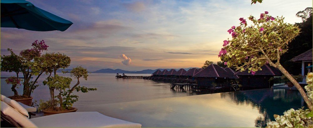 Hotels Outdoors + Adventure sky water outdoor Boat vacation tourism Resort Sea bay dusk several