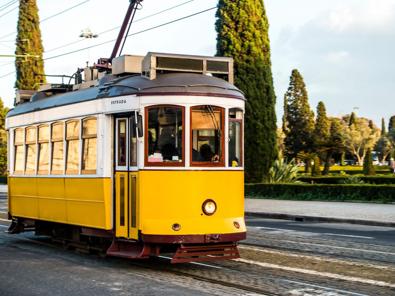 Trip Ideas outdoor sky transport yellow vehicle land vehicle tram track rolling stock cable car train traveling public transport electricity railroad car metropolitan area