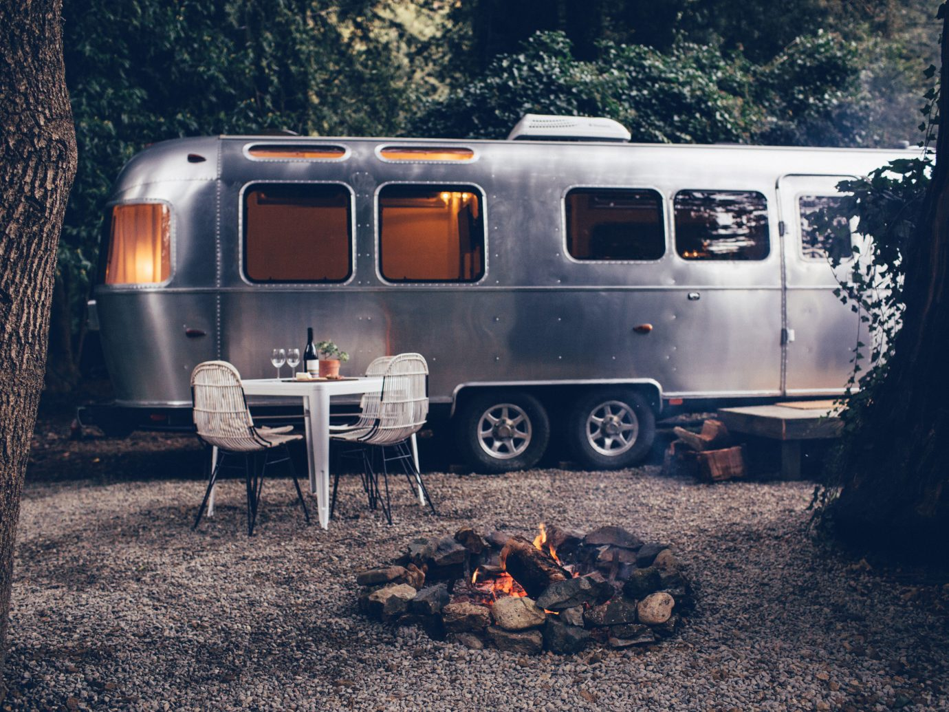 Glamping Luxury Travel Outdoors + Adventure tree outdoor ground transport vehicle car camper trailer