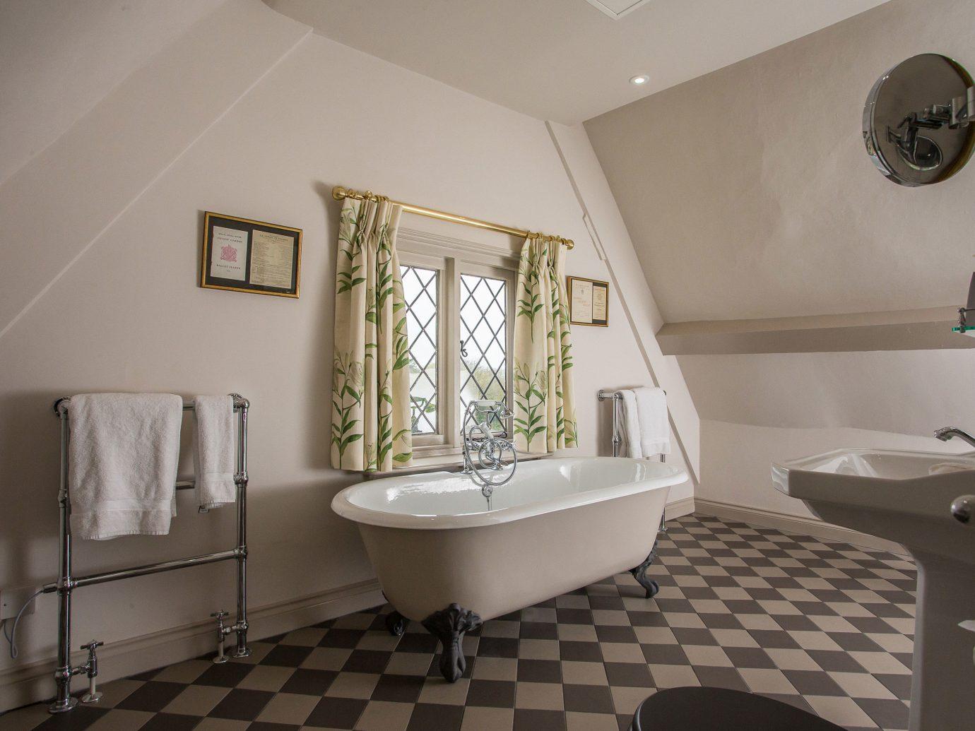 Hotels wall indoor bathroom floor room property home estate interior design sink cottage Design bathtub real estate apartment plumbing fixture tub tiled Bath tile furniture