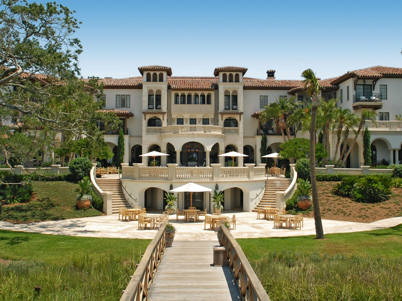 Beach Islands Luxury Travel Trip Ideas grass outdoor sky property estate mansion building home Villa real estate park historic house hacienda house landscaping facade Courtyard lawn official residence elevation stone walkway colonnade