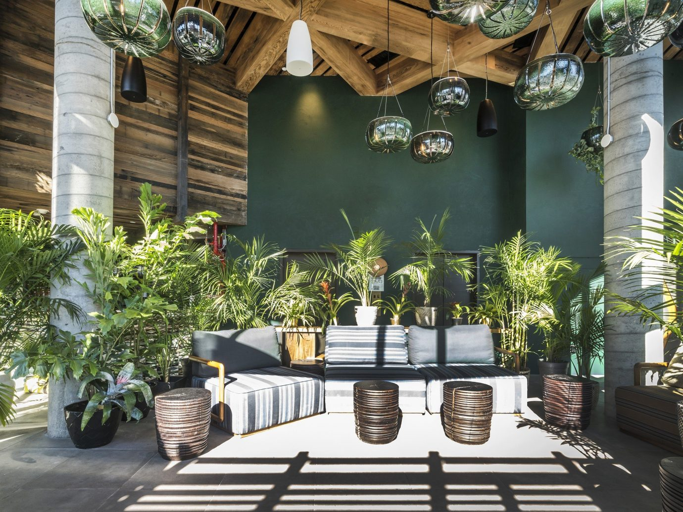Boutique Hotels Food + Drink Hotels tree plant Courtyard home outdoor structure Patio interior design real estate arecales backyard house estate Garden landscaping palm tree decorated furniture