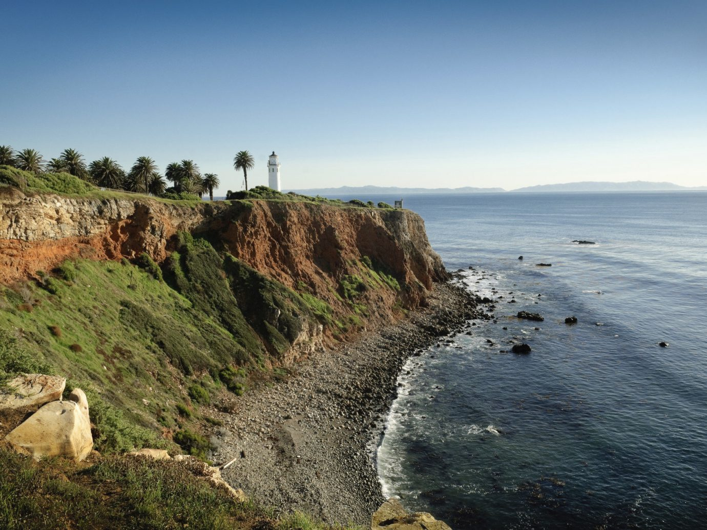 Trip Ideas sky outdoor Coast Nature cliff Sea landform geographical feature shore body of water water Ocean rock mountain terrain hill rocky landscape cape Beach bay geology wave tower hillside
