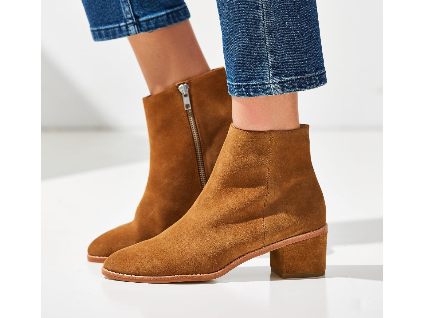 Style + Design person clothing footwear leather brown boot shoe leg textile suede outdoor shoe human body material shoes feet