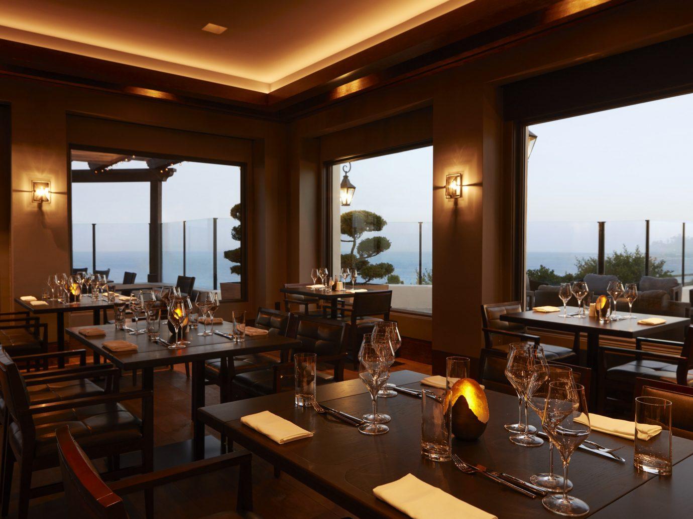 Hotels table window indoor ceiling restaurant room property meal interior design estate café Resort Bar dining room function hall Island furniture