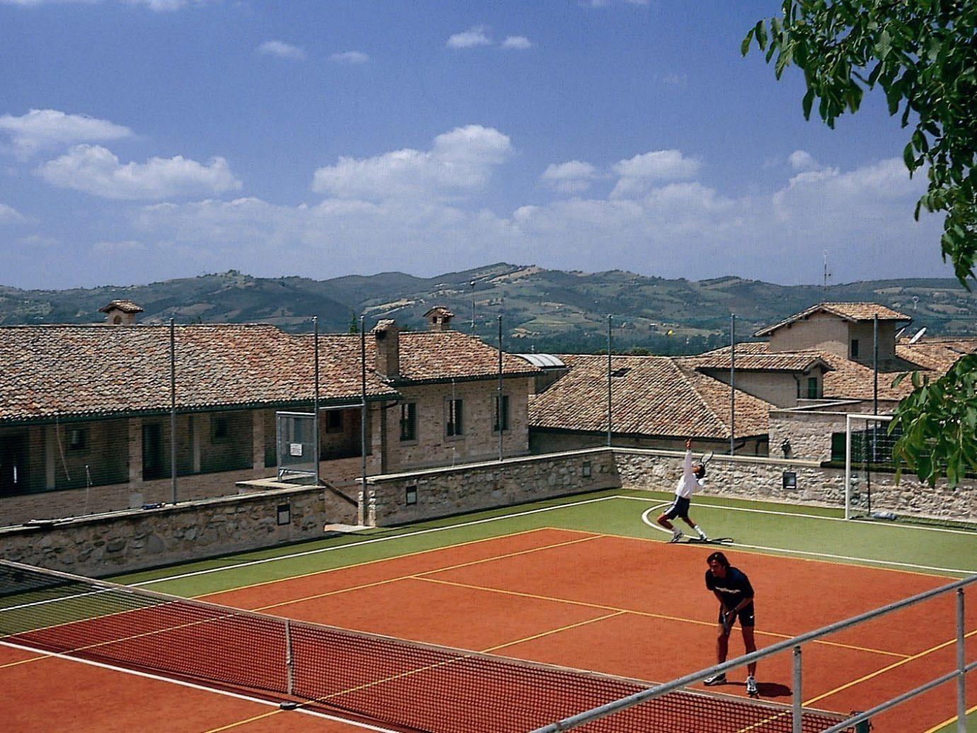 sky outdoor structure sport venue tennis court sports estate stadium net
