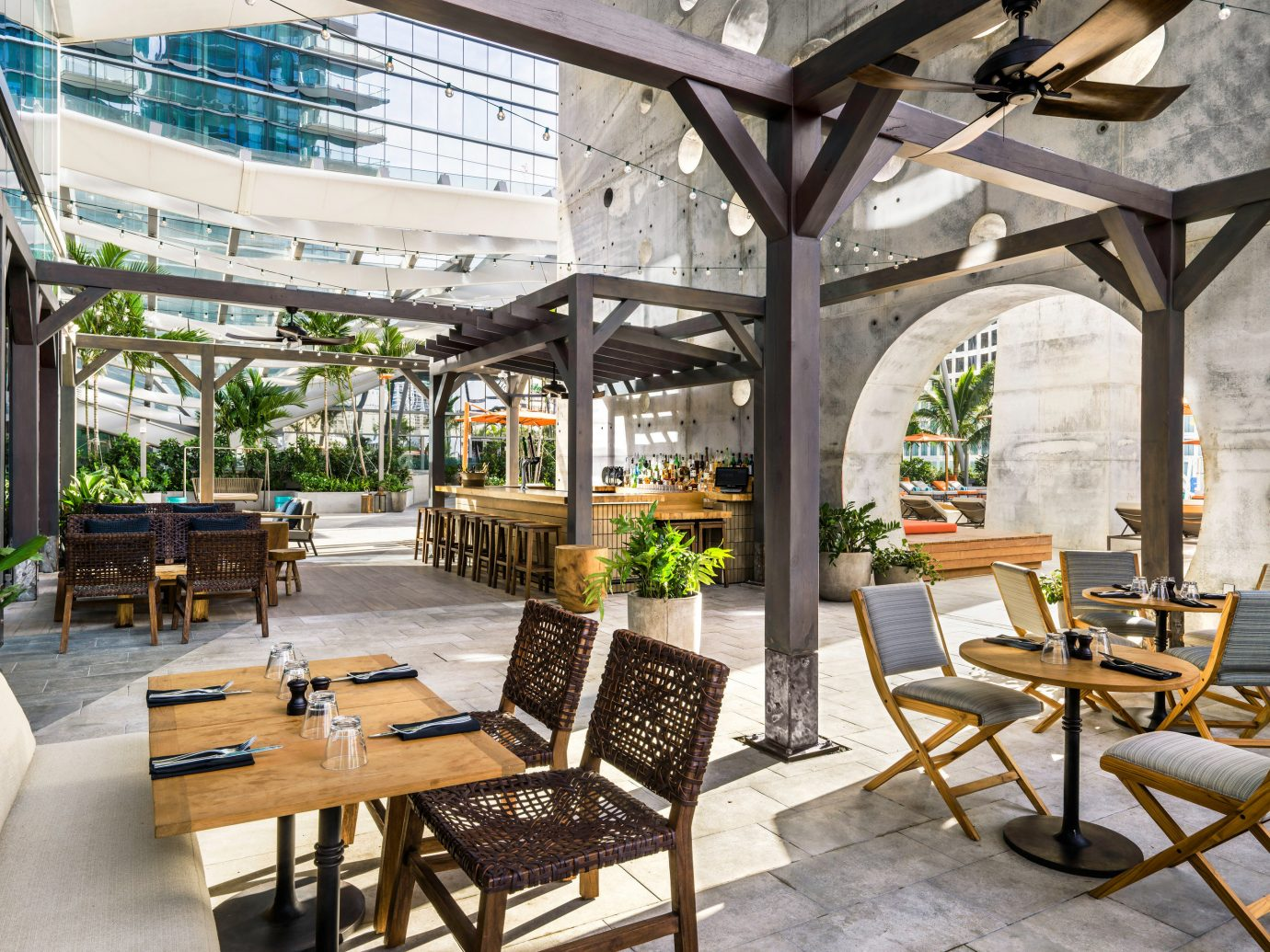 Food + Drink ground table chair outdoor room restaurant estate outdoor structure real estate Courtyard interior design Resort plaza orangery Patio porch Lobby furniture