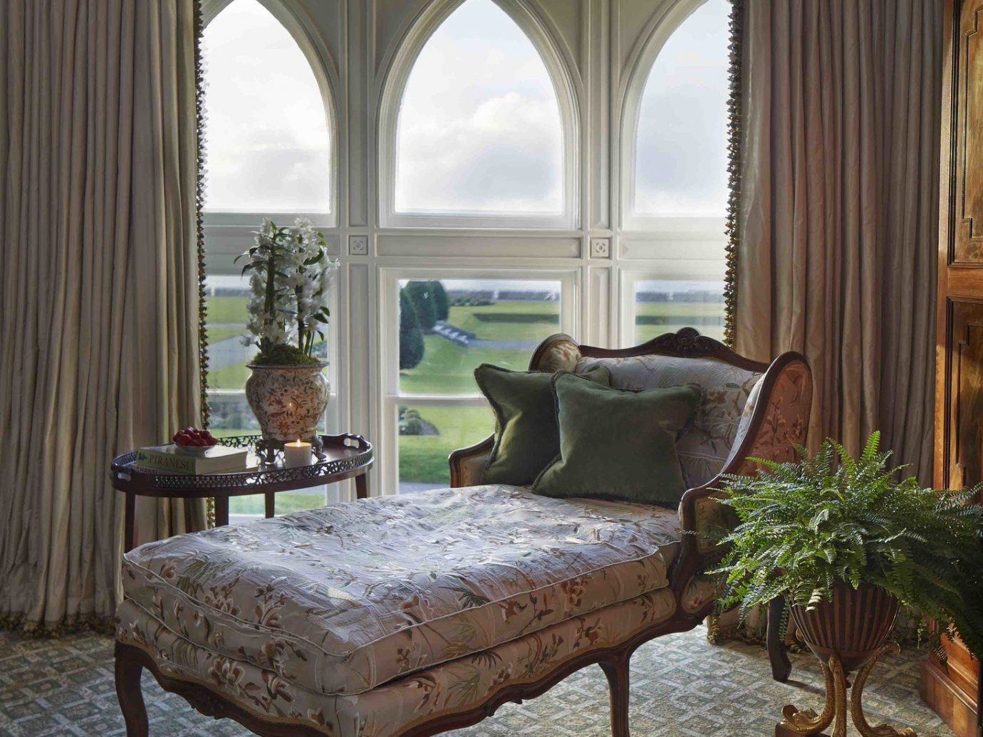 Hotels room property furniture living room estate table interior design home wood floor dining room mansion window porch window covering