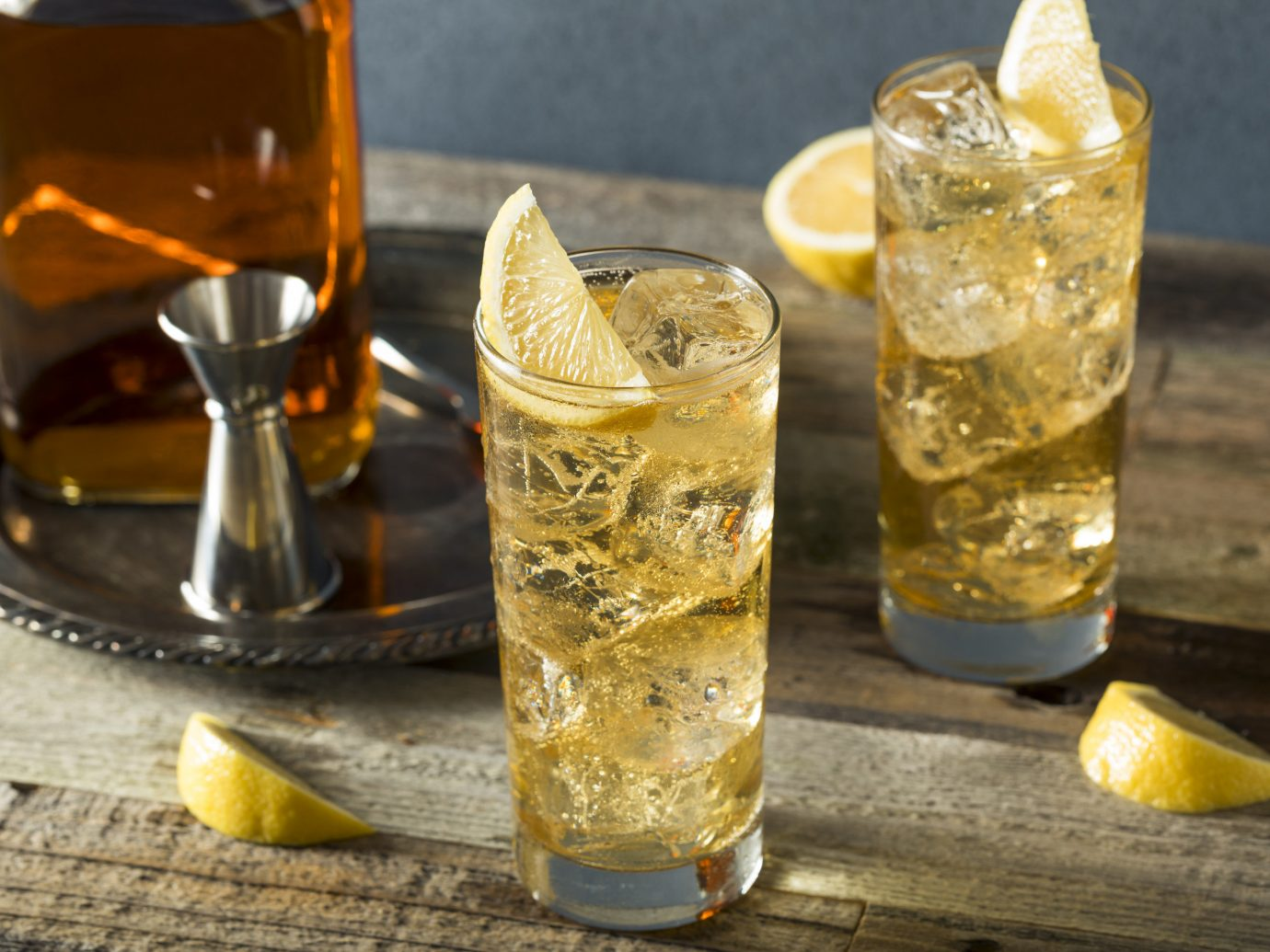 Food + Drink cup Drink alcoholic beverage yellow cocktail distilled beverage mint julep citrus produce cuba libre highball beverage alcohol glass