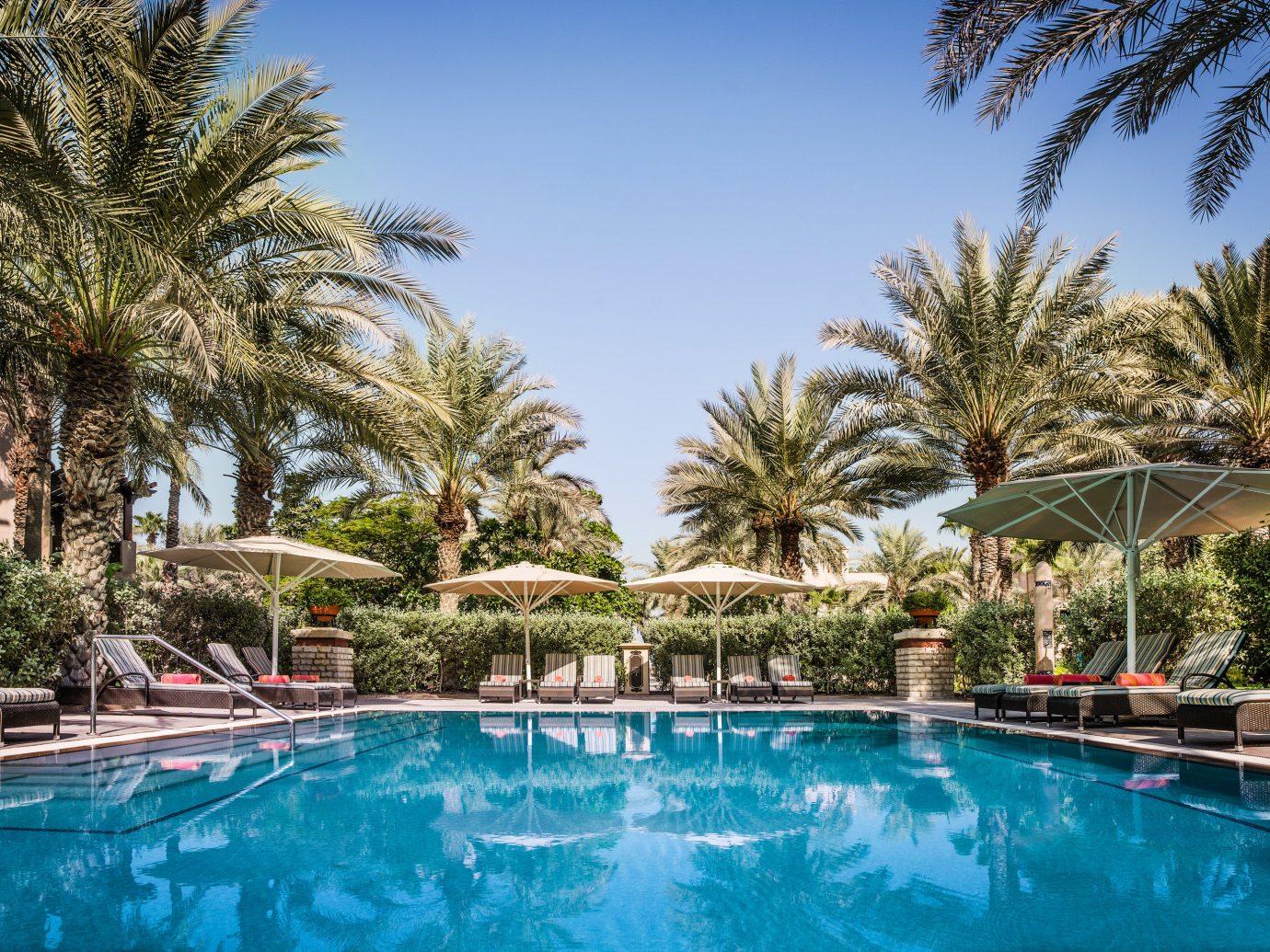 Dubai Hotels Luxury Travel Middle East Resort swimming pool property palm tree arecales tree water leisure real estate plant estate Villa sky vacation hotel resort town tropics hacienda tourism